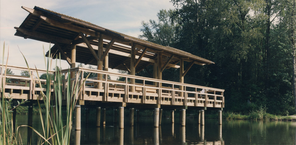 <p>Fishtrap Creek Park - Entry Pier - Abbotsford, BC</p><p>Fishtrap Creek Park is a stormwater retention area designed by Landscape Architect Catherine Berris. Within the park are 6 structures including an Entry Pier, Bridge, Reading Shelter, Picnic Shelter, Railway Observation Deck, and a Boardwalk. Completed in 1995.</p>
