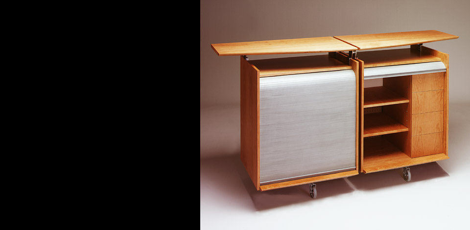 <p>Stereo Cabinet</p><p>1996</p><p>Designed as a multi-purpose Audio-Visual cabinet for a residence in West Vancouver. The top slides open allow for more surface area to place hot foods on the granite top.</p><p>Cherry veneer plywood, with cold rolled steel tube structure, and granite top.</p><p>Height 38'' Depth 23'' Length 66''</p>